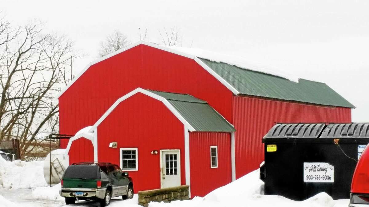 A barn collapsed on Wednesday on Jackson Hill Road. No animals were injured when a structure located at the rear of the main barn, pictured, folded under the weight of snow.