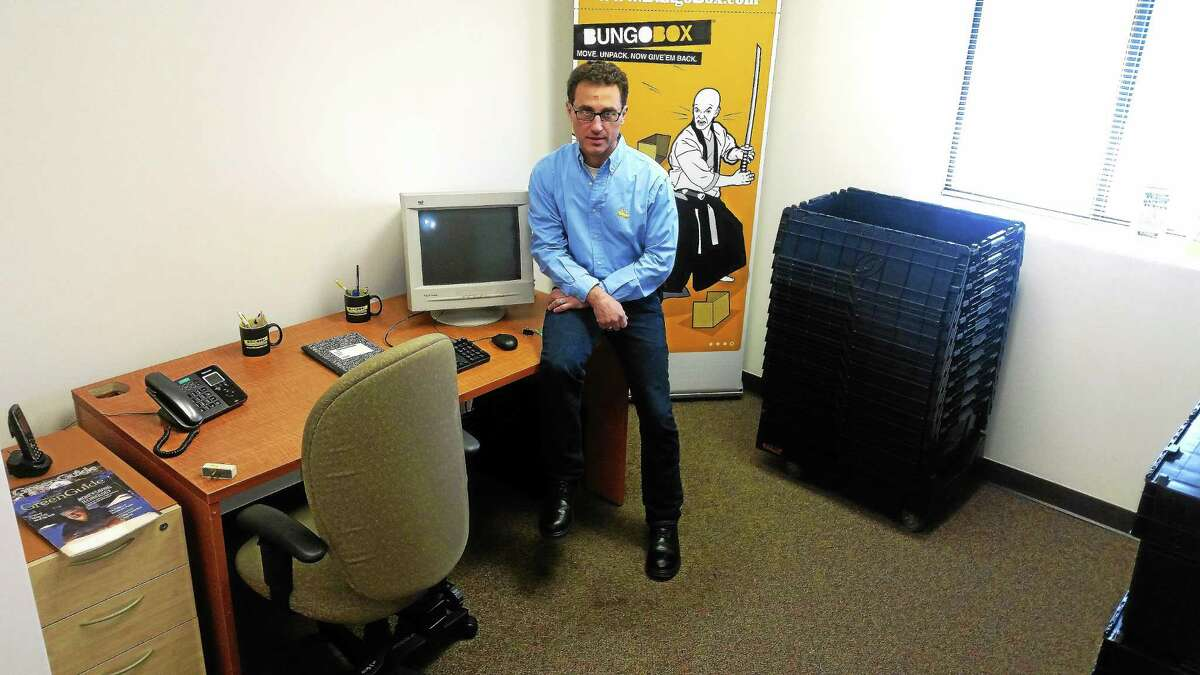 Kathleen Schassler/Middletown Press Property agent Peter Mendlinger has partnered with Mark Balaban to offer co-working rental spaces at @425 Main St. Mendlinger rents two offices @425. Pictured is office space for BungoBox, a franchise that rents-delivers-retrieves plastic moving boxe.s