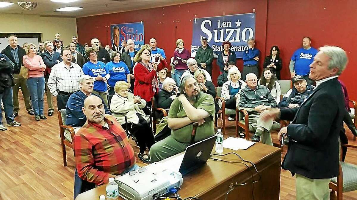 Republican Len Suzio comes in to headquarters in Meriden to applause on election night, saying he grateful for support.