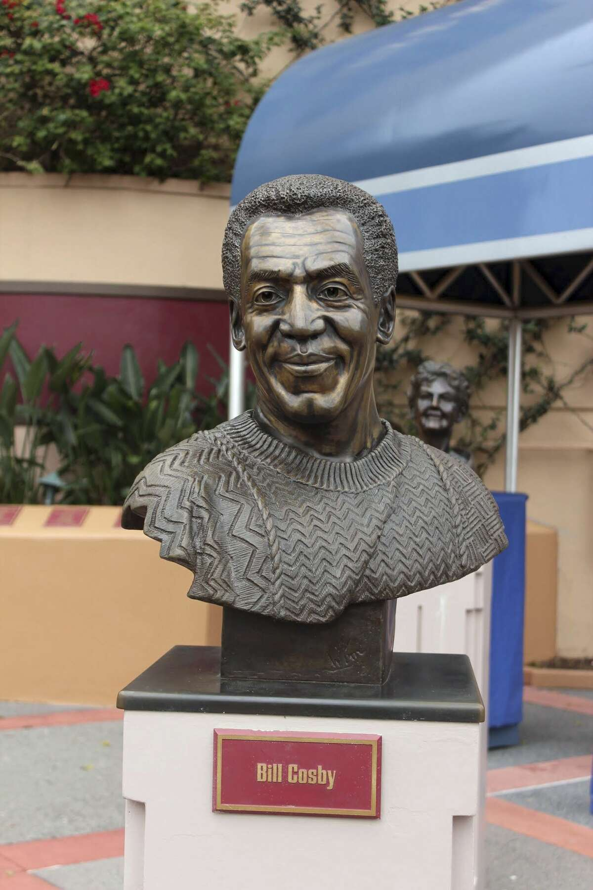 In this Feb. 26 photo, a bust of actor and comedian Bill Cosby is on display at Hollywood Studios theme park in Orlando, Fla. Local news outlets reported that Walt Disney World officials removed the bust from the park late July 7 after court documents unsealed Monday revealed that Cosby testified in 2005 that he obtained Quaaludes with the intent of giving them to women he wanted to have sex with.