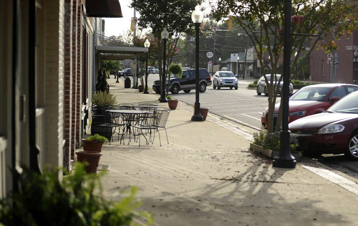 """This photo taken Wednesday, July 8, 2015, shows a quiet sidewalk in downtown Monroeville, Ala., the hometown of """"To Kill a Mockingbird"""" author Harper Lee. Lee's second novel, """"Go Set a Watchman,"""" is due for release July 14, 2015."""