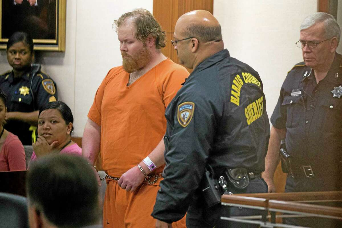 Ronald Lee Haskell is escorted by deputies for a hearing on Friday, July 11, 2014, in Houston. Haskell, 33, is accused of killing his ex-wife's sister, Katie Stay, her husband and the children, ranging in age from 4 to 14, after binding and putting them face-down on the floor of their suburban Houston home. (AP Photo/Houston Chronicle, Brett Coomer, Pool)