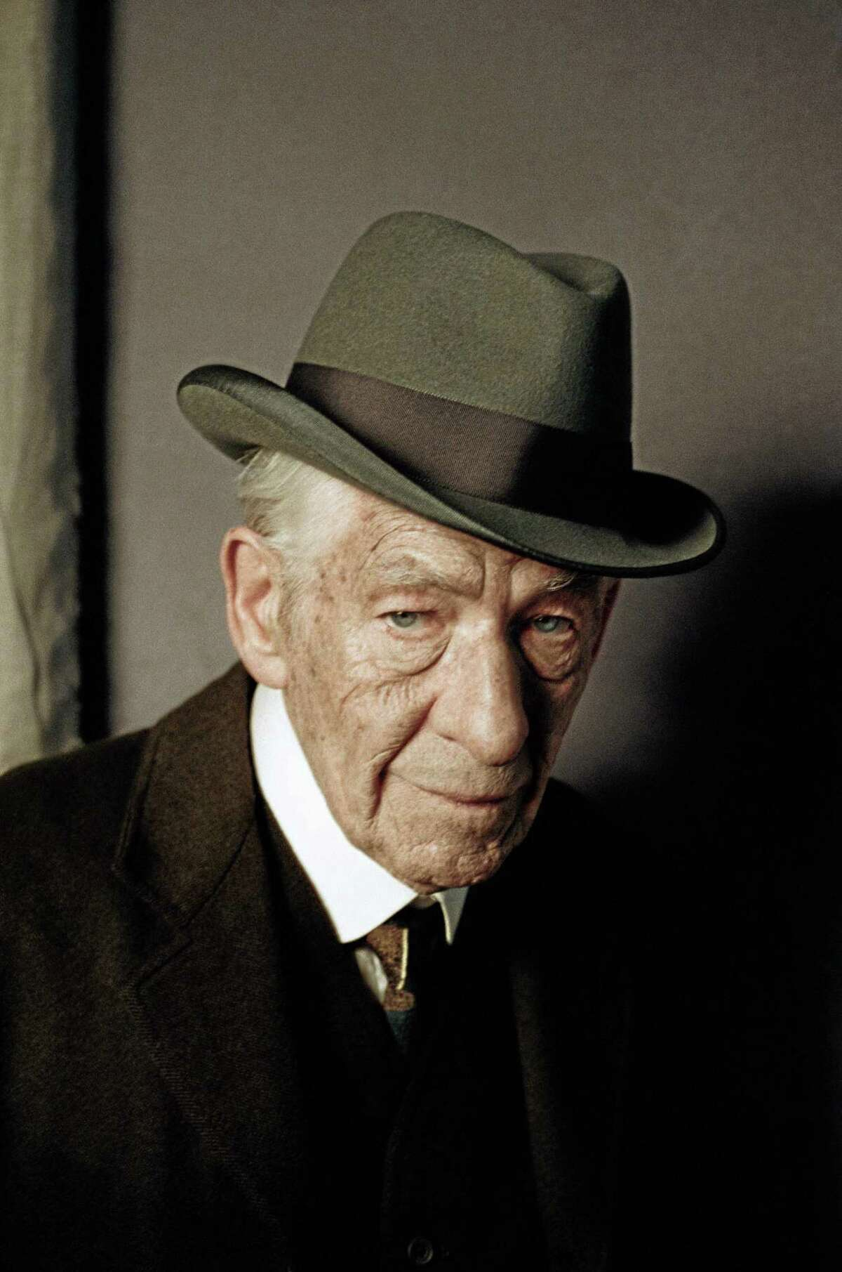 """In this undated photo released by See-Saw Films, British actor Ian McKellen poses for a photograph on the first day of filming for """"Mr. Homes"""", in which he portrays a 93-year-old Sherlock Holmes, London. Filming has begun on ìMr. Holmes,î which imagines the famous sleuth in his old age as a retiree living in seclusion by the sea. The movie, based on Mitch Cullinís novel ìA Slight Trick of the Mind,î sees the detective struggling with a failing memory and revisiting one final unresolved mystery. (AP Photo/Agatha A Nitecka, See-Saw Films)"""