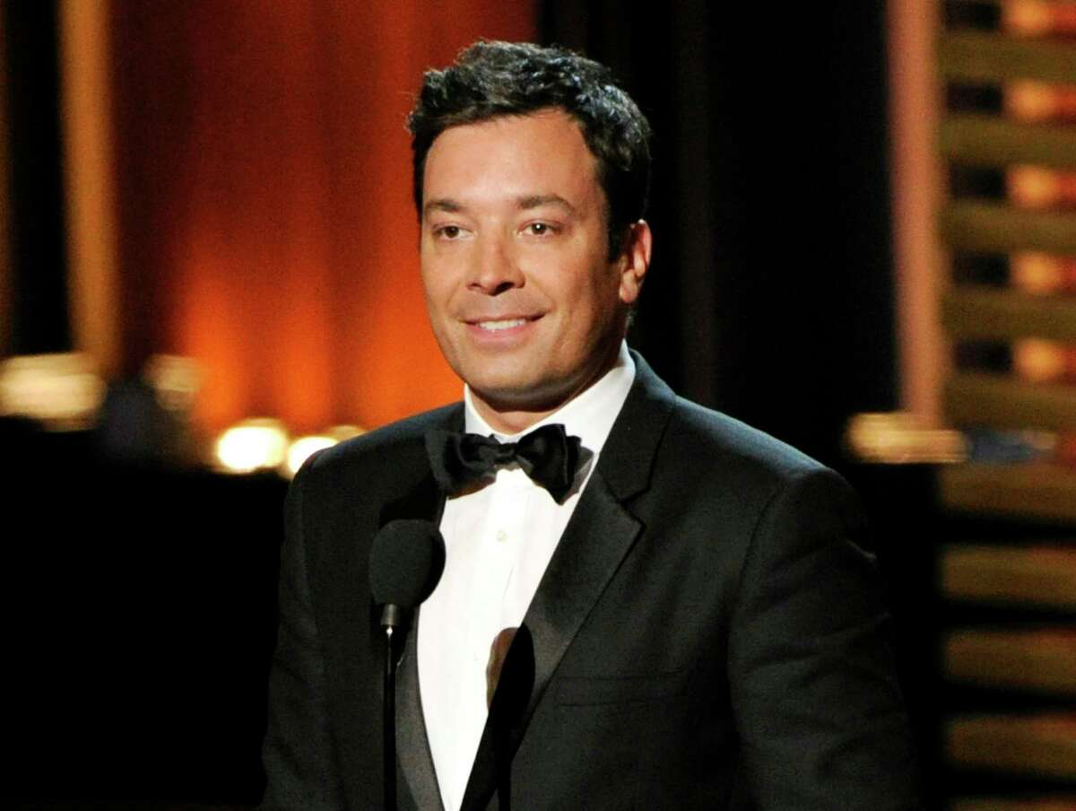 In this Aug. 25, 2014 photo, Jimmy Fallon presents an award at the 66th Annual Primetime Emmy Awards in Los Angeles.