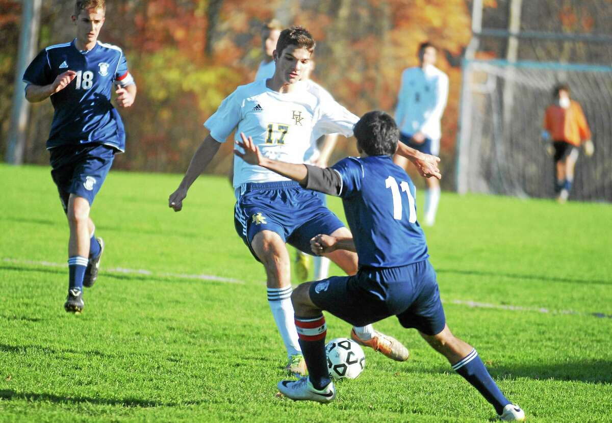Haddam-Killingworth's Michal Narowski looks to pass as Immaculate's Joao Vieira moves in during the first half.