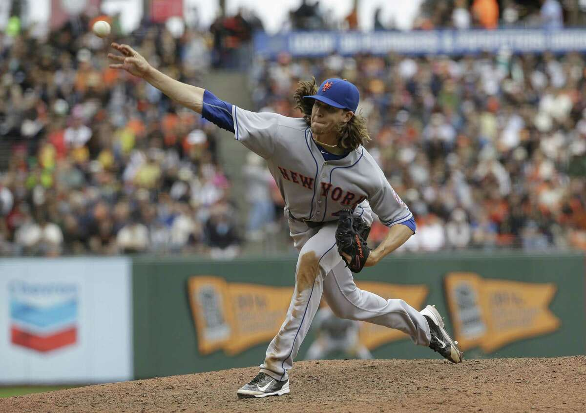 Mets pitcher Jacob deGrom allowed two hits over eight scoreless innings against the Giants on Wednesday.