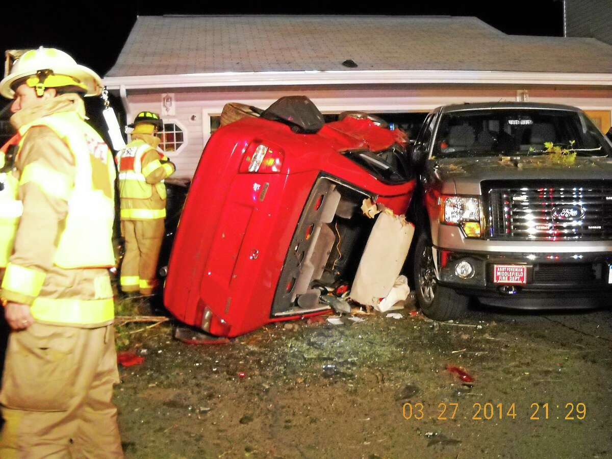 Edwin Rodriquez of Meriden was charged after he lost control of his car while evading police and hit four parked cars at the home of Middlefield Fire Chief Peter Tyc. Submitted photo.
