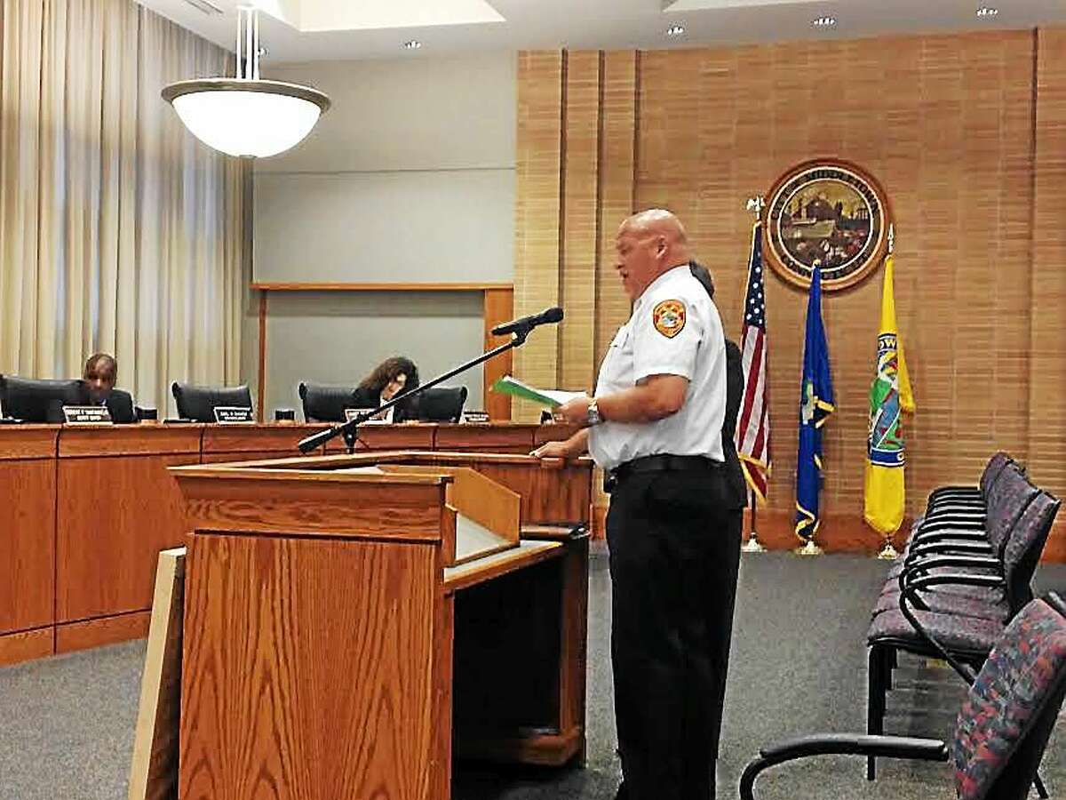 Fire Chief Robert Kronenberger and Human Relations director Faith Jackson present their case for changing the firefighter job description to allow applicants without EMT certification onto the force.