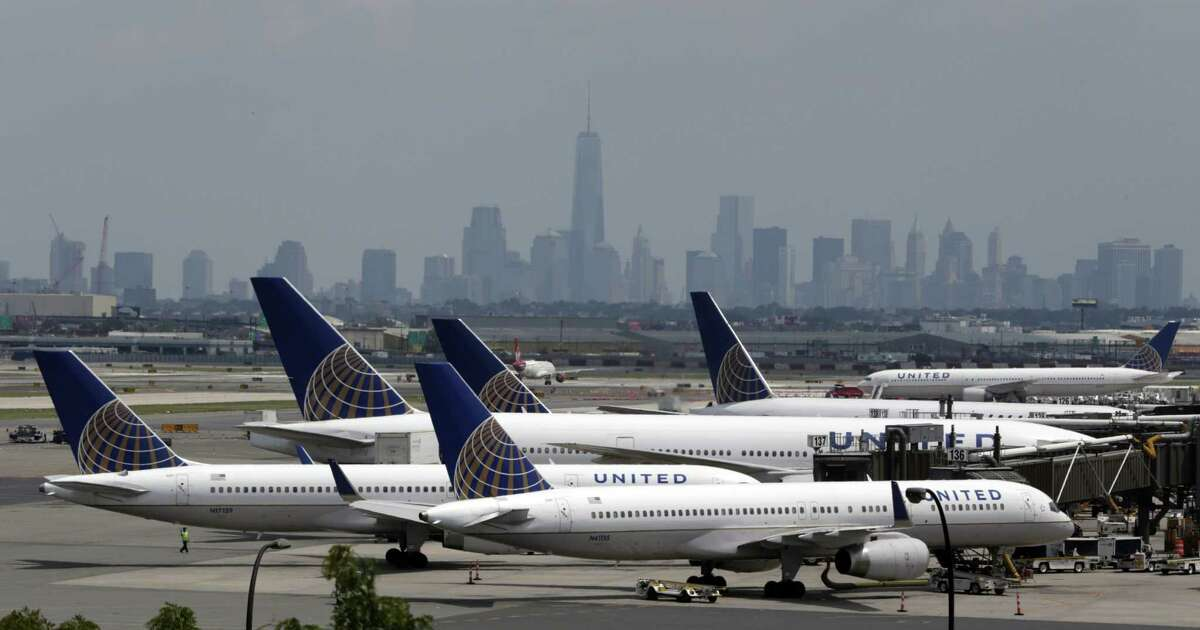In this July 2014 file photo, United Airlines jets are parked on the tarmac at Newark Liberty International Airport, in Newark, N.J.