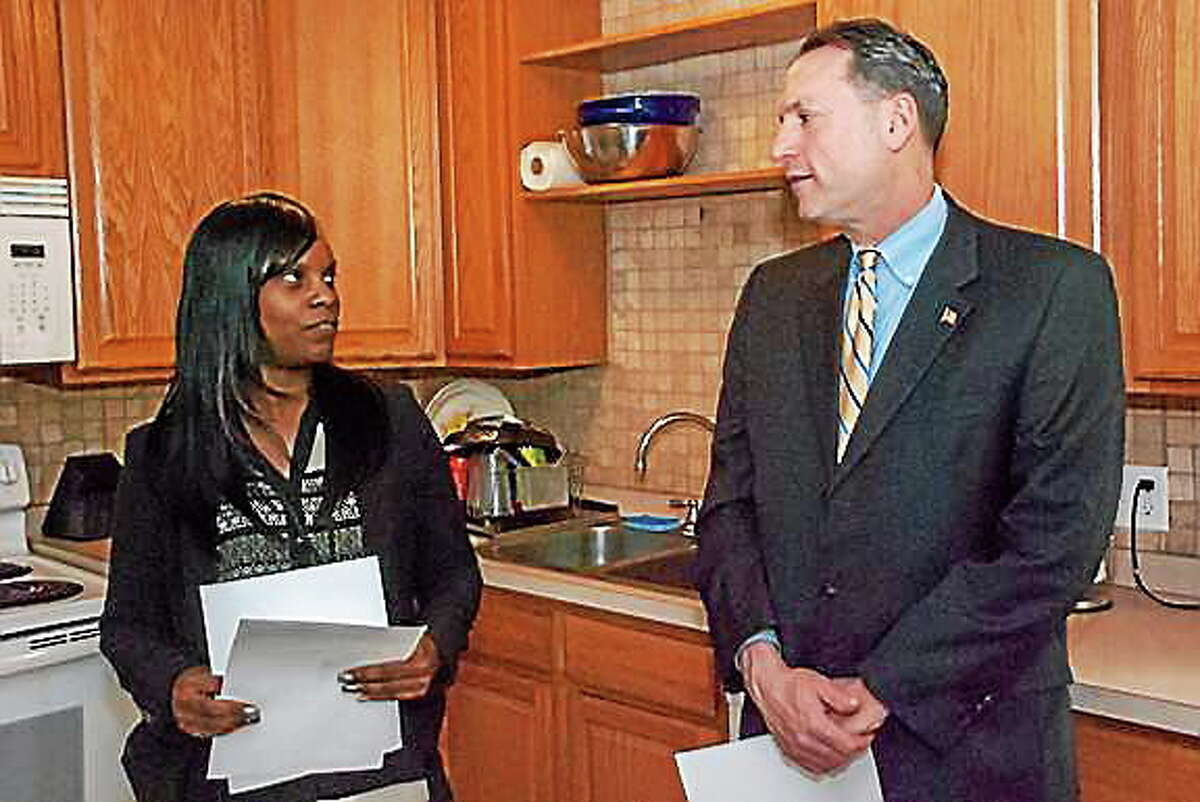 Submitted photo State Sen.Paul Doyle, D-Wethersfield, talks with The Connection Program Director Rosalyn Biggins at a recent visit to Middletown.