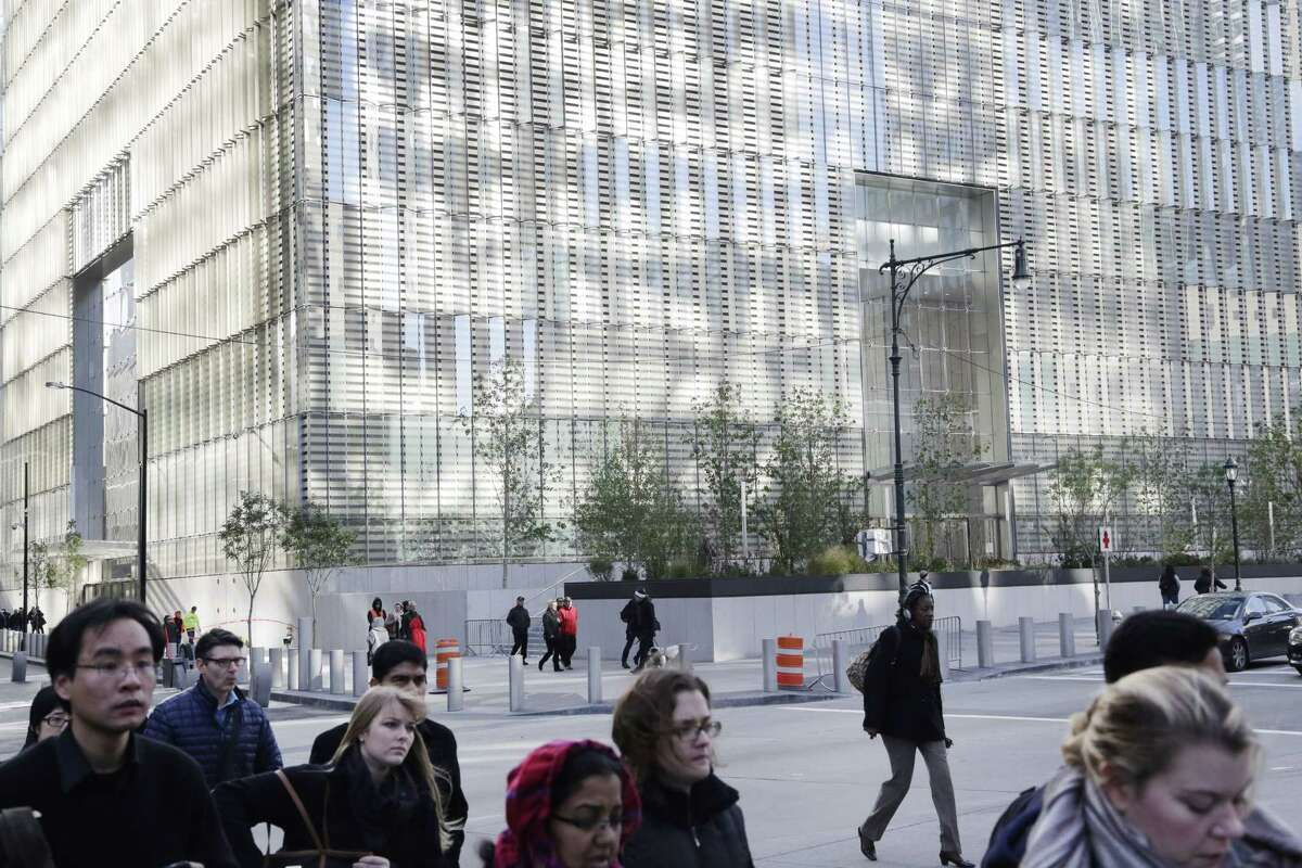 People walk past One World Trade Center on Nov. 3, 2014, in New York.
