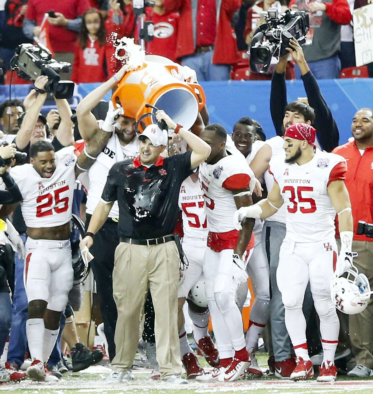 Houston head coach Tom Herman gets the Gatorade bath as the Cougars win the Peach Bowl 38-24 over Florida State on Thursday in Atlanta.