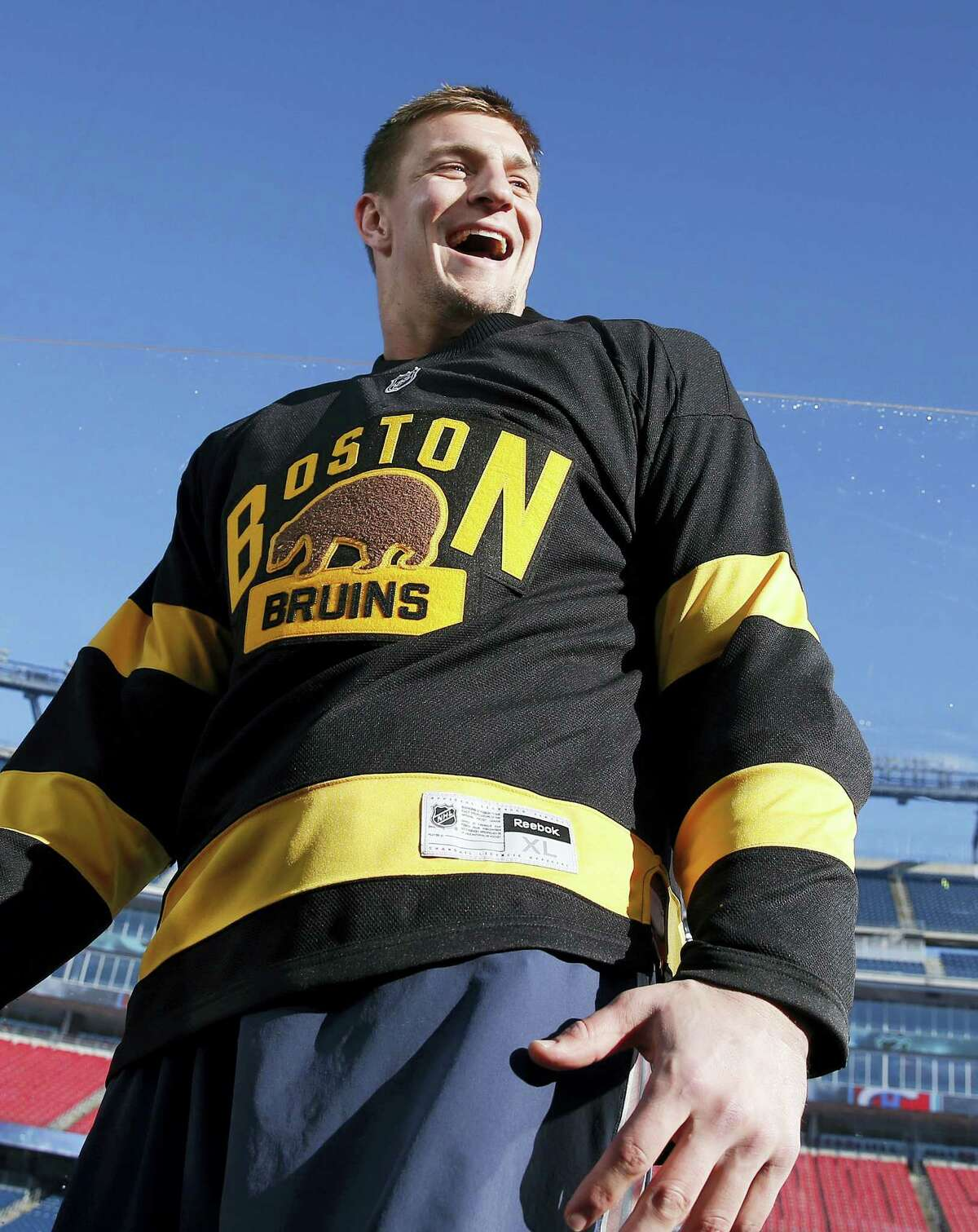 New England Patriots tight end Rob Gronkowski wears a Boston Bruins jersey on Thursday at Gillette Stadium in Foxborough, Mass.