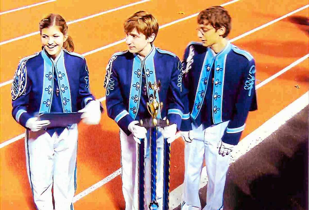 The city's high school marching band won first place in Group VI at the Northeast Regional championships.