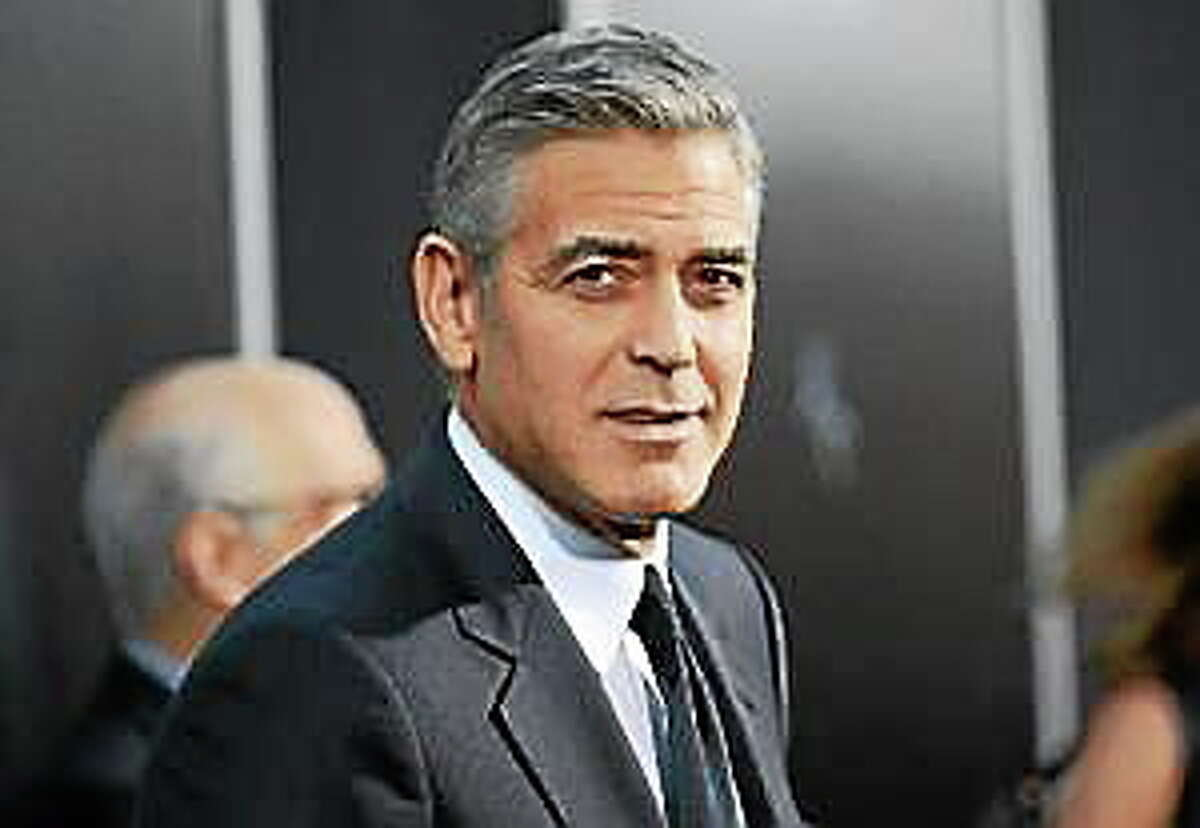 """George Clooney attends the premiere of """"Gravity"""" at the AMC Lincoln Square Theaters, in New York."""
