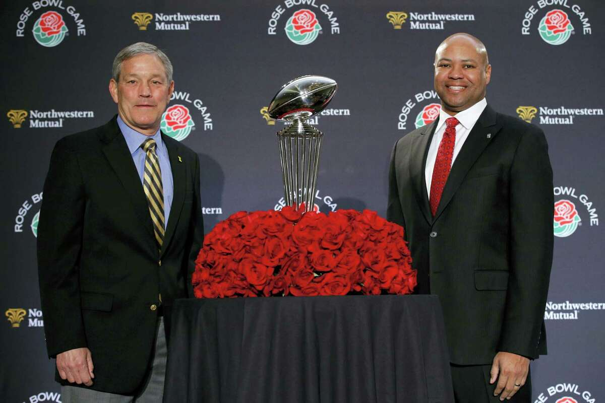 Stanford head coach David Shaw, right, and Iowa head coach Kirk Ferentz pose for photos during a news conference for the Rose Bowl Wednesday in Los Angeles.