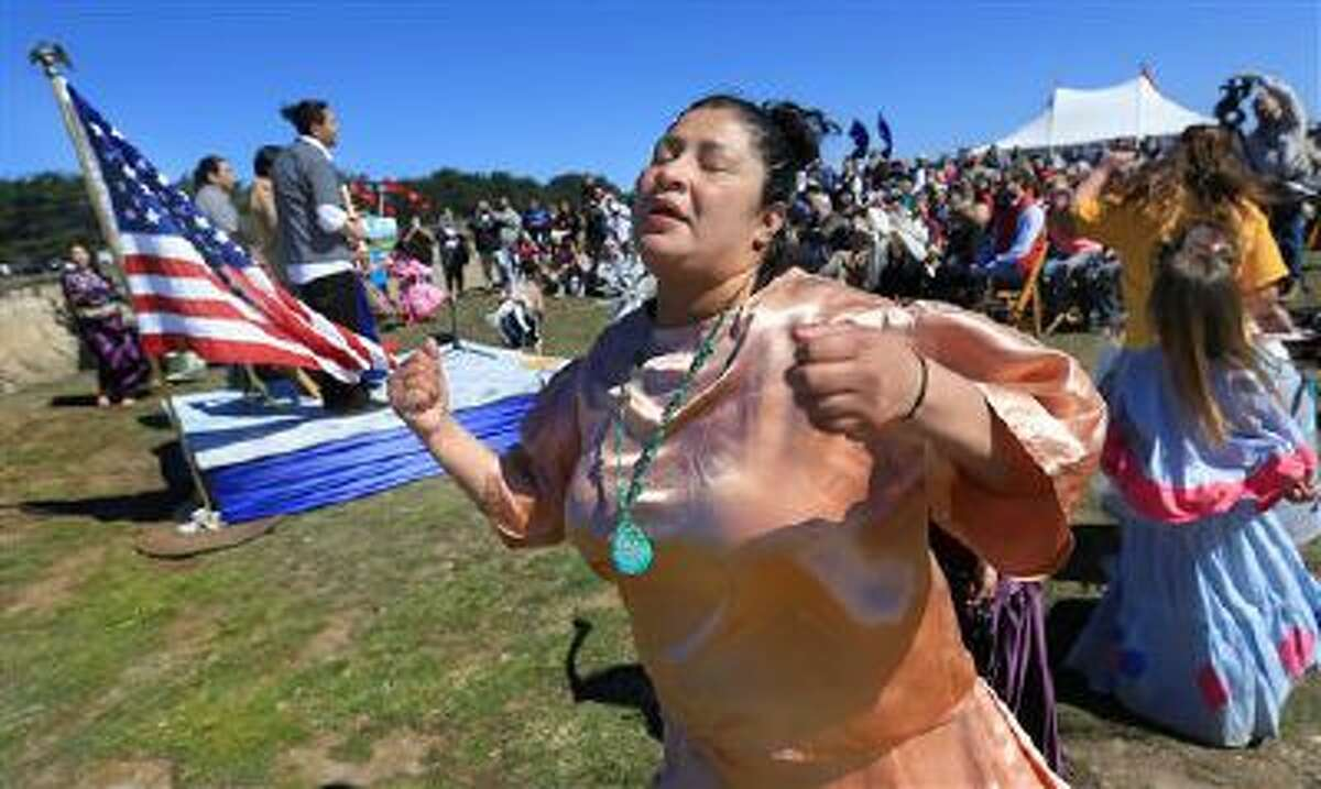 Olivia Rios of the Manchester Band of Pomo Indians dance group, helps to dedicate the Point Arena-Stornetta Public Lands as an official part of the 1,100-mile California Coastal National Monument in Point Arena, Ca., USA, Wednesday March 12, 2014 in Mendocino County. (AP Photo, Kent Porter, Santa Rosa Press Democrat)