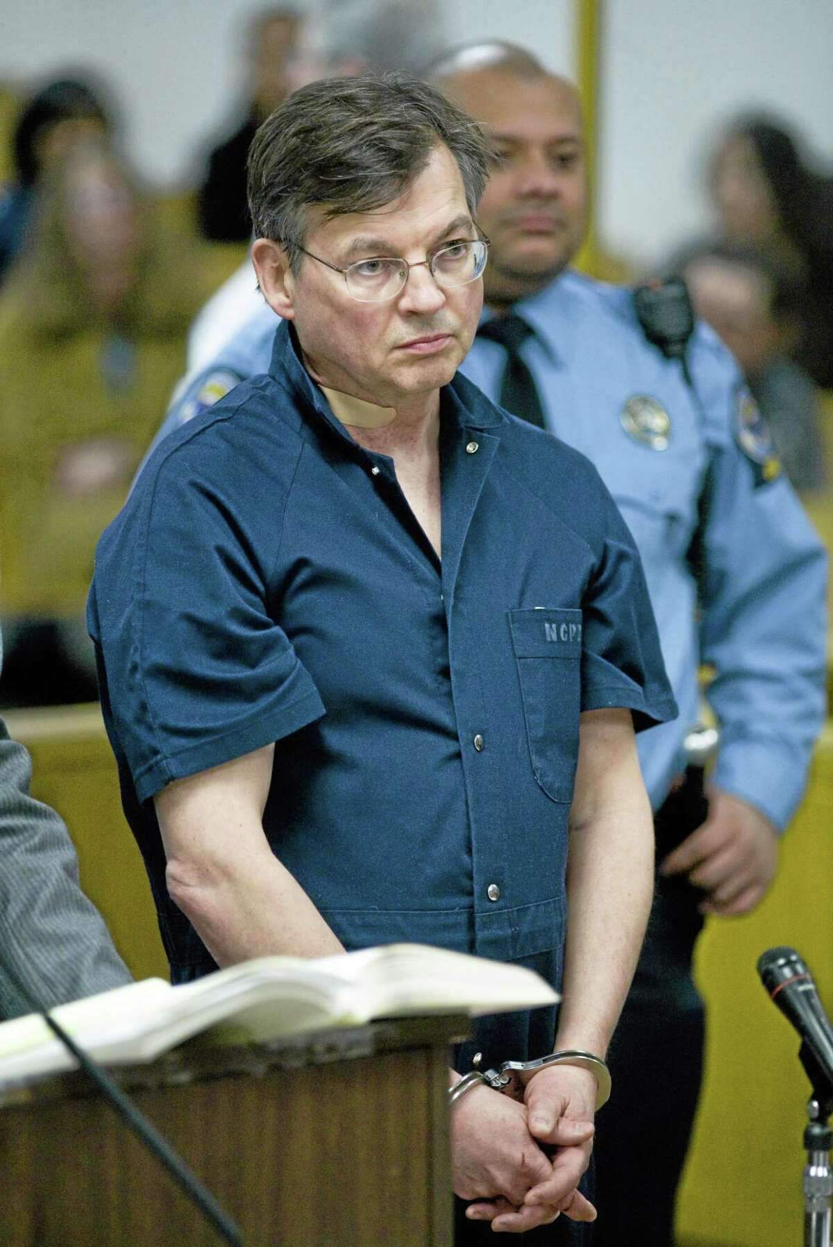 In this Jan. 7, 2010, file photo, John Michael Farren of New Canaan, Conn, is arraigned in state Superior Court in Norwalk, Conn. Farren, former White House lawyer in both Bush administrations was convicted Friday, July 11, 2014, of attempted murder and other charges in the beating of his wife at their Connecticut home four years ago.
