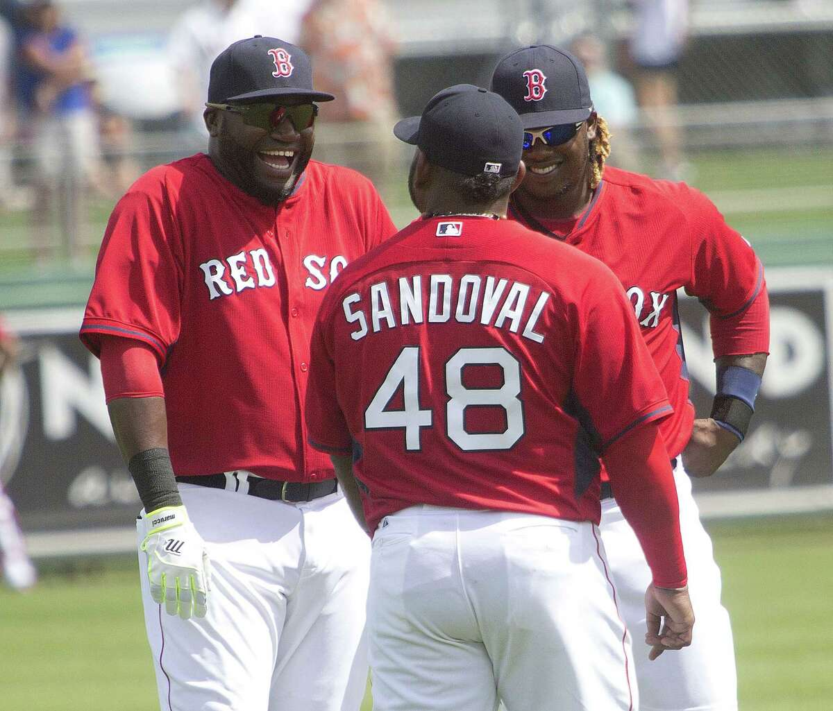 From left, Red Sox players David Ortiz, Pablo Sandoval and Hanley Ramirez chat during Tuesday's game against Northeastern in Fort Myers, Fla. Boston beat both Northeastern and Boston College by one run.