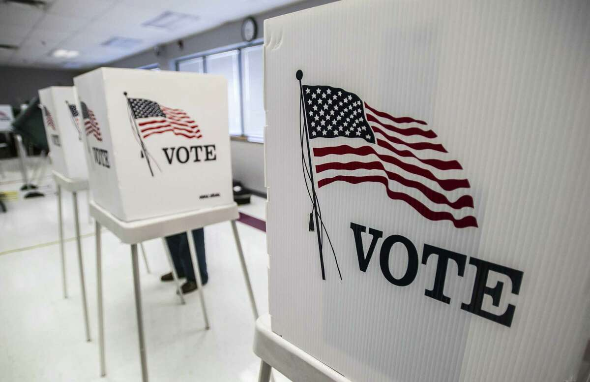 FILE - In this May 20, 2014 file photo, a person votes in the primary election at The Boyle County Fire Department in Danville, KY. (AP Photo/The Advocate Messenger, Clay Jackson, File)