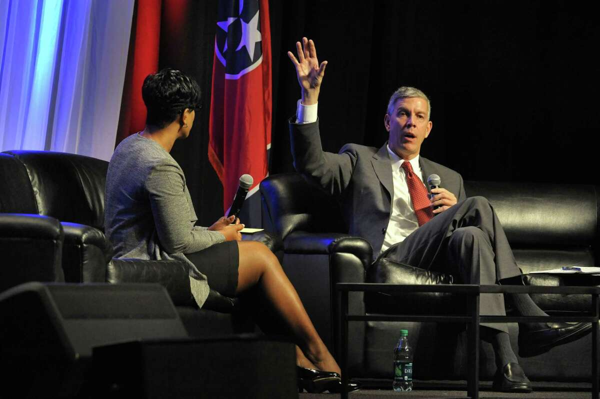 U.S. Education Secretary Arne Duncan, right, answers questions through moderator Sheryl Randolph, of Hamilton County at the LEAD education conference at the Music City Center, Tuesday, Oct. 28, 2014, in Nashville, Tenn. Duncan spoke about the importance of strong school leadership. (AP Photo/The Tennessean, John Partipilo)