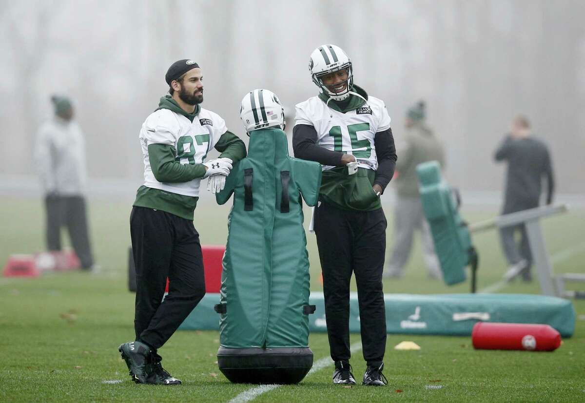 New York Jets wide receivers Eric Decker (87) and Brandon Marshall (15) lean on a blocking dummy before practice Wednesday in Florham Park, N.J.