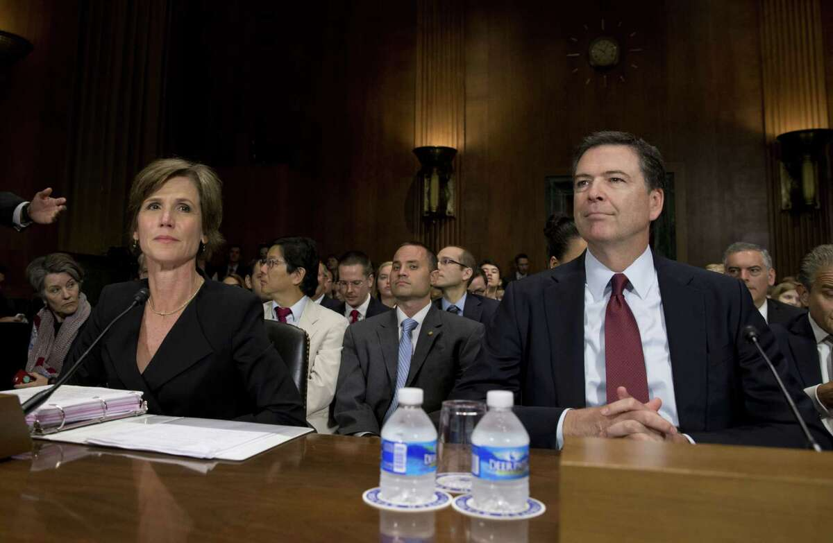 """FBI Director James Comey, right, and Deputy Attorney General Sally Quillian Yates, are seated as they arrive to testify at the Senate Judiciary Committee hearing on Capitol Hill in Washington on July 8, 2015 entitled """"Going Dark: Encryption, Technology, and the Balance Between Public Safety and Privacy."""""""