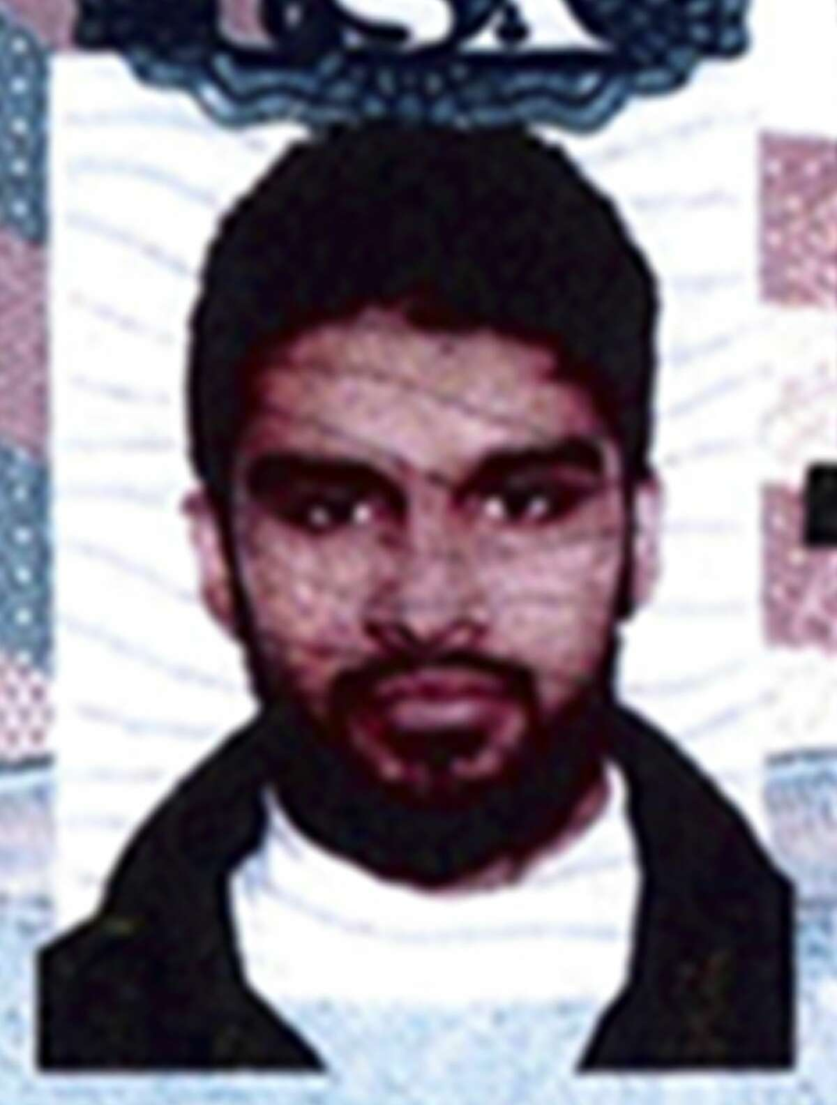 This undated passport photo provided by the U.S. attorney's office and presented as evidence at a detention hearing at federal court in Chicago, Monday, Nov. 3, 2014, shows Mohammed Hamzah Khan.