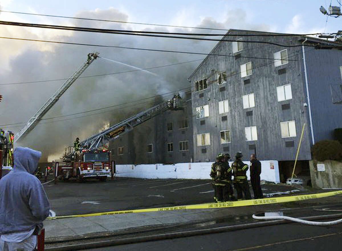 Firefighters battle a fire that destroyed a large apartment building on Charles Street in Bridgeport Thursday morning, Dec. 31, 2015. Bridgeport officials said the fire at the condominium left more than 100 people homeless.