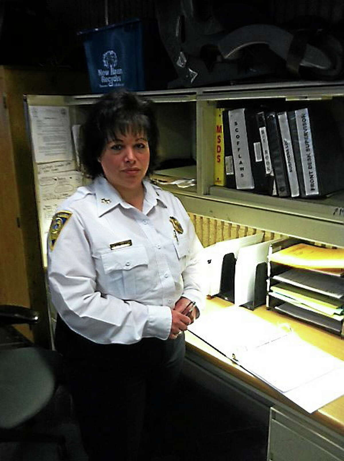 New Haven police have an arrest log now available for the public to review, after they failed a Freedom of Information compliance check conducted by staff at the New Haven Register and sister newspapers. Assistant Chief of Police Denise Blanchard stands next to the new arrest log. It is available for viewing 24 hours a day, seven days a week. (Michelle Tuccitto Sullo — New Haven Register)