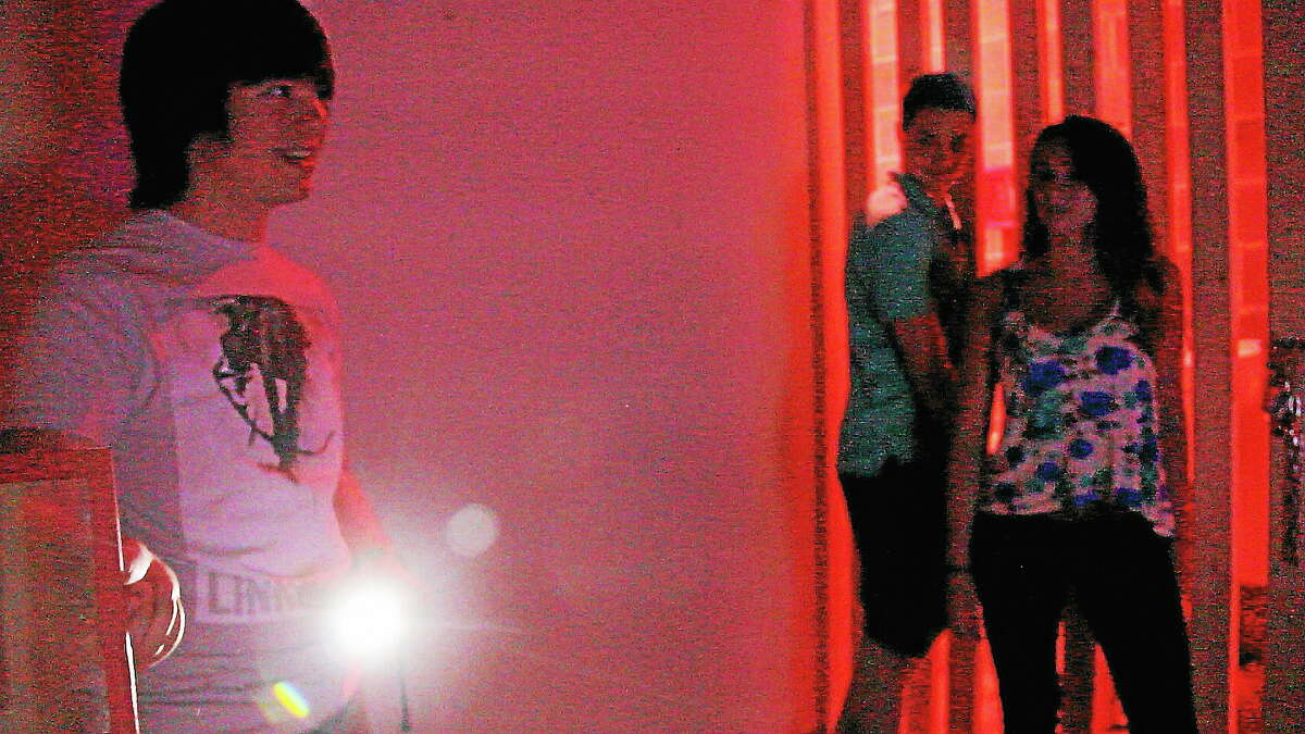 Kathleeen Schassler/West Hartford News ¬ Game master Zackery Graham briefs Adventure Room participants Mia Sgamboti and Erik Koontz as they begin a maze with a 60-minute deadline.