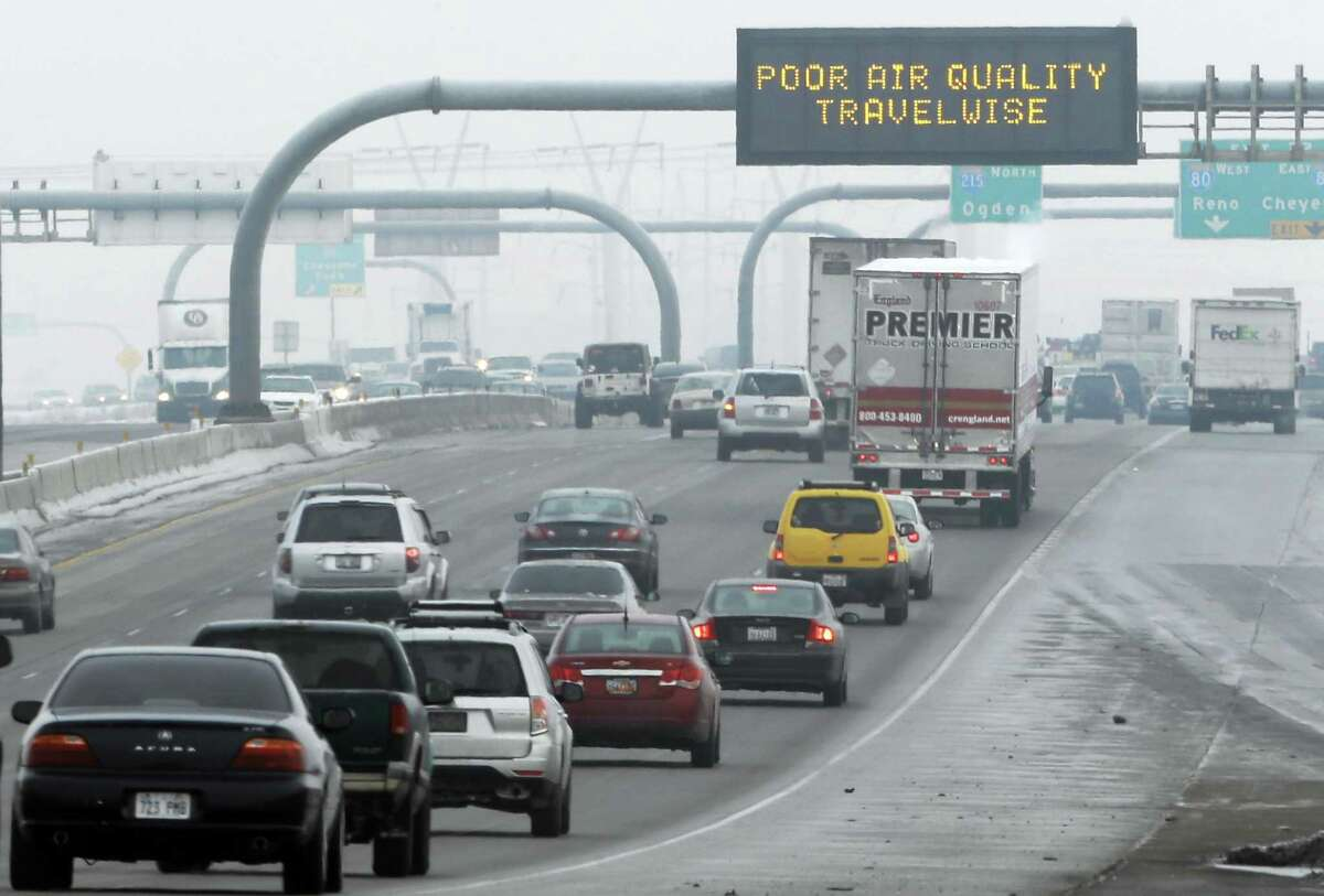 This Jan. 23, 2013, file photo, shows a poor air quality sign posted over a highway in Salt Lake City. A new government report released Jan. 13, 2014, says energy-related carbon dioxide pollution increased slightly in 2013 after declining for several years in a row.