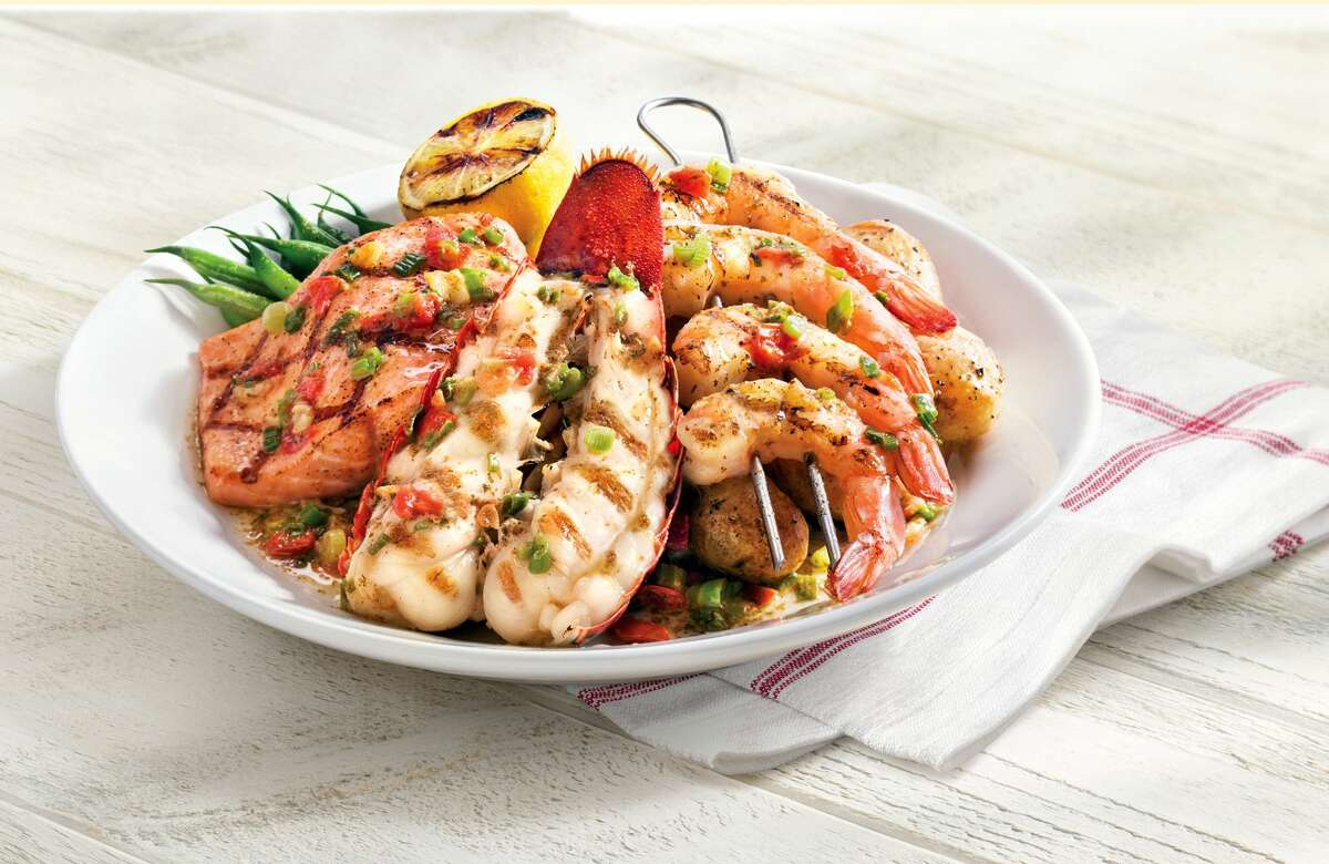Red Lobster's new Wood-Grilled Lobster, Shrimp and Salmon dish.