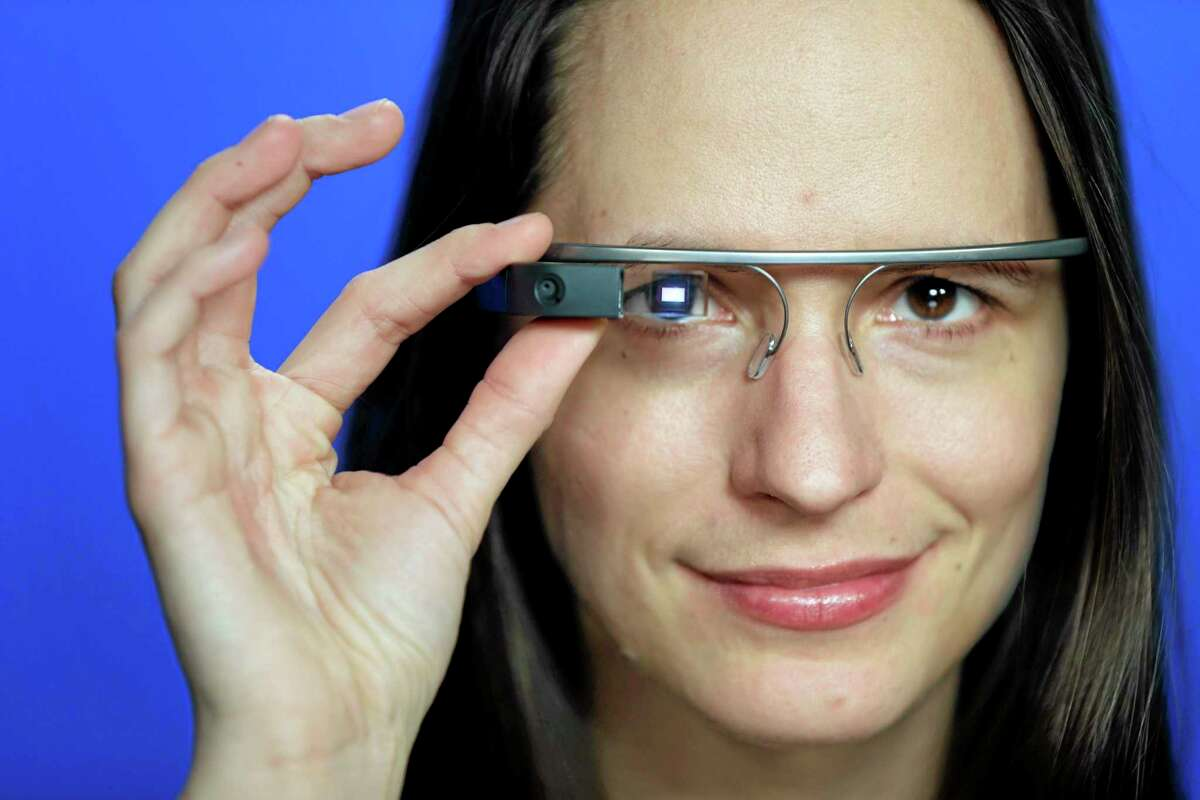 FILE - In this Feb. 21, 2014 file photo, Associated Press Technology Writer Barbara Ortutay poses wearing Google Glass in New York. (AP Photo/Seth Wenig, File)