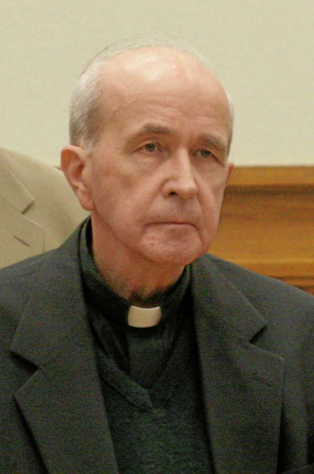FILE - In this photo made Thursday, May 11, 2006, in Toledo, Ohio, the Rev. Gerald Robinson listens as the verdict is read finding him guilty of killing Sister Margaret Ann Pahl. Robinson, a Roman Catholic priest, died Friday morning, July 4, 2014, at a Columbus prison hospice unit, said his attorney, Richard Kerger. He was 76. A federal court had refused Thursday to release Robinson so he could die in his hometown, Toledo. (AP Photo/Andy Morrison, Pool, File)