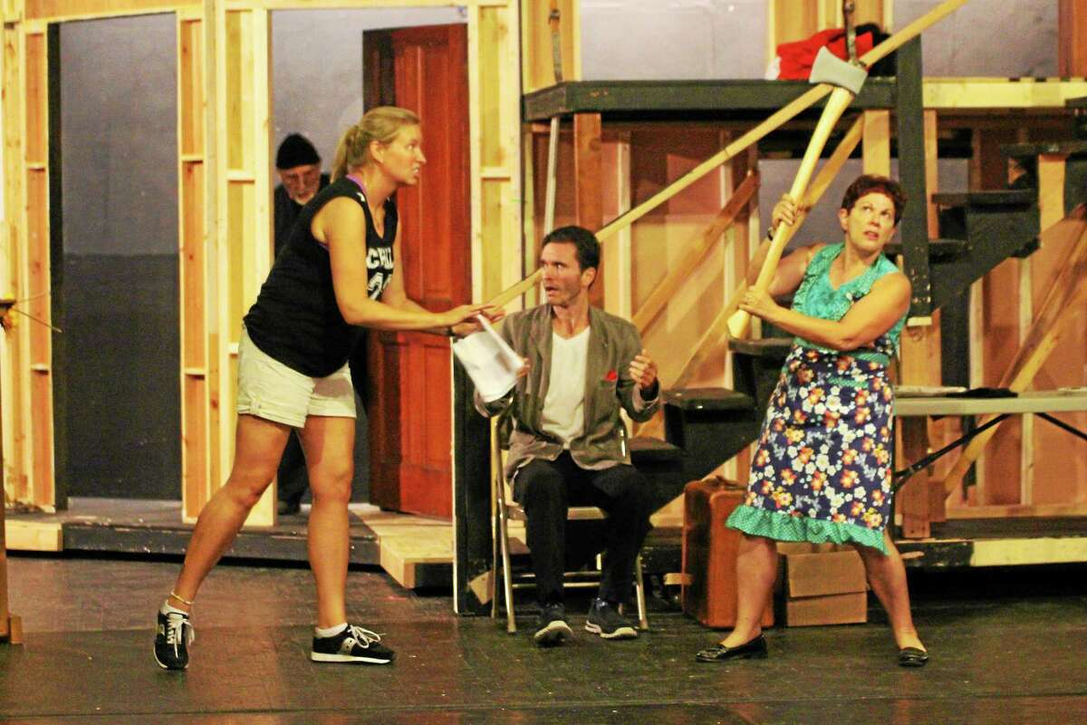 """Contributed photo The cast of """"Noises Off!"""" rehearses a scene from the comical farce at the Repertory Theater in New Britain."""