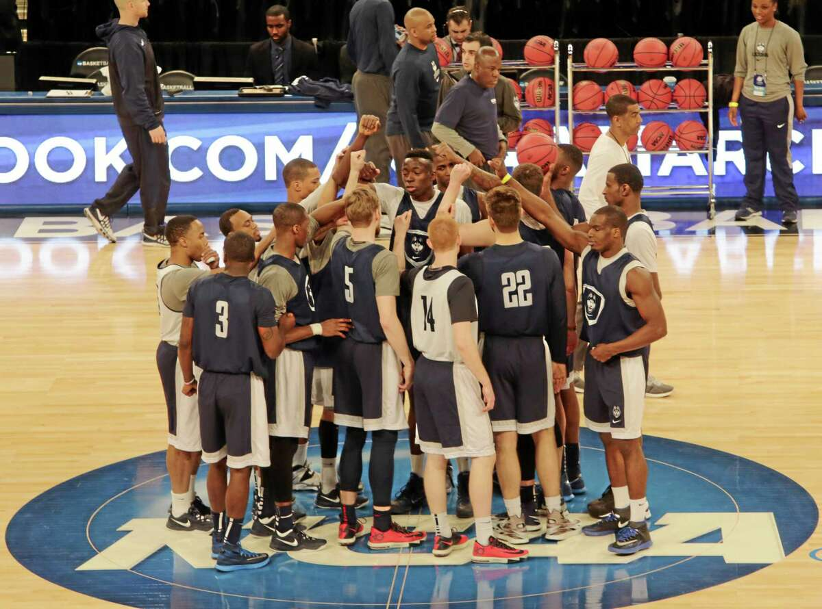 UConn players gather at midcourt at Madison Square Garden during practice on Thursday. The Huskies play Iowa State in a regional semifinal tonight.