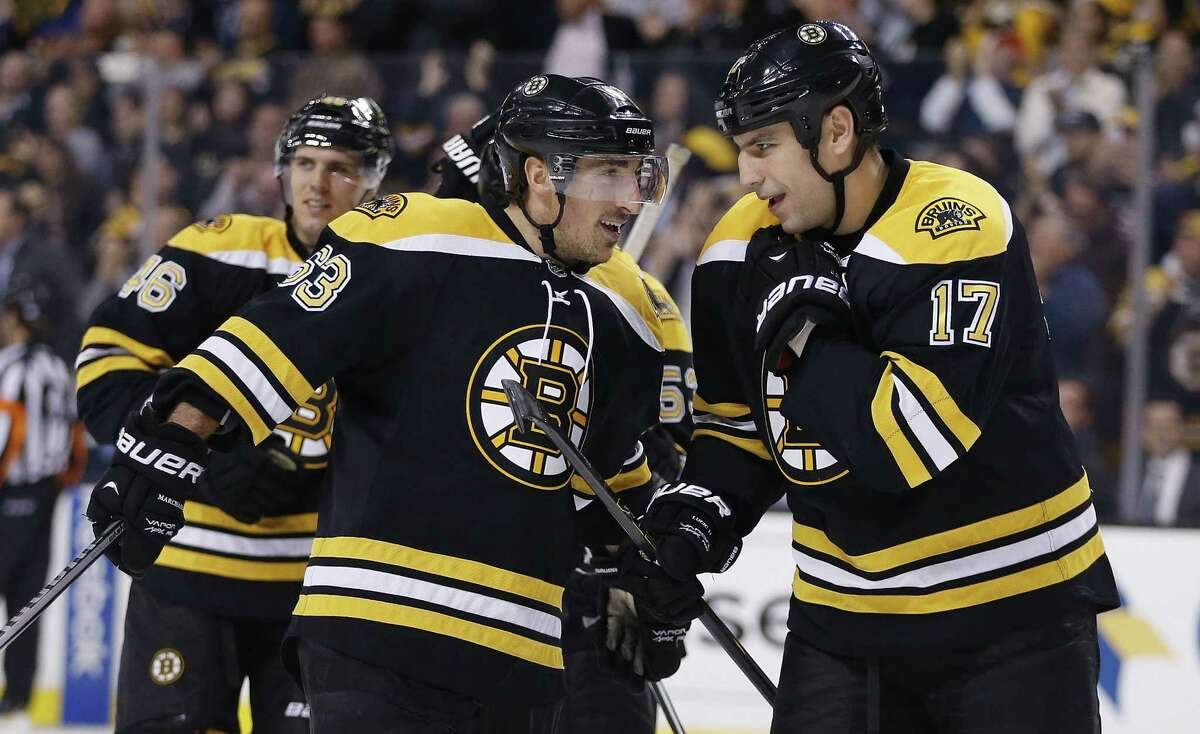 The Bruins' Milan Lucic (17) celebrates a goal with teammate Brad Marchand during a recent game.