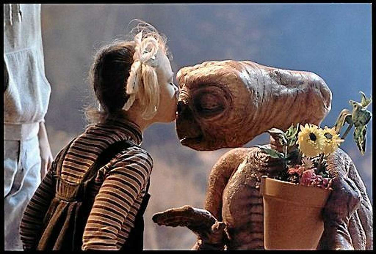 """Drew Barrymore as Gertie and E.T. are shown in a scene from """"E.T.: The Extra-Terrestrial,"""" which will be screened Saturday on Foss Hill at Middletown's Wesleyan University."""