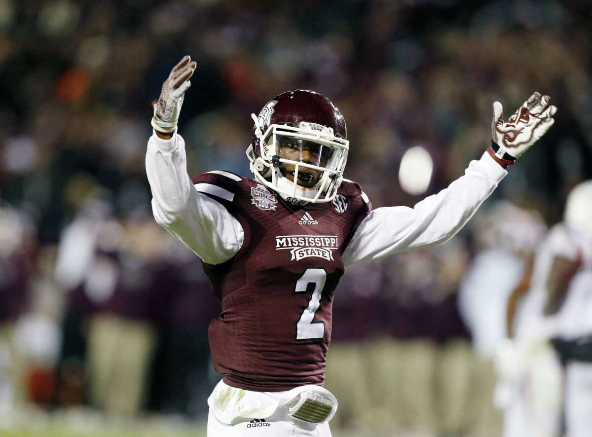 Mississippi State defensive back Will Redmond (2) encourages fan support against Arkansas in the second half Saturday.