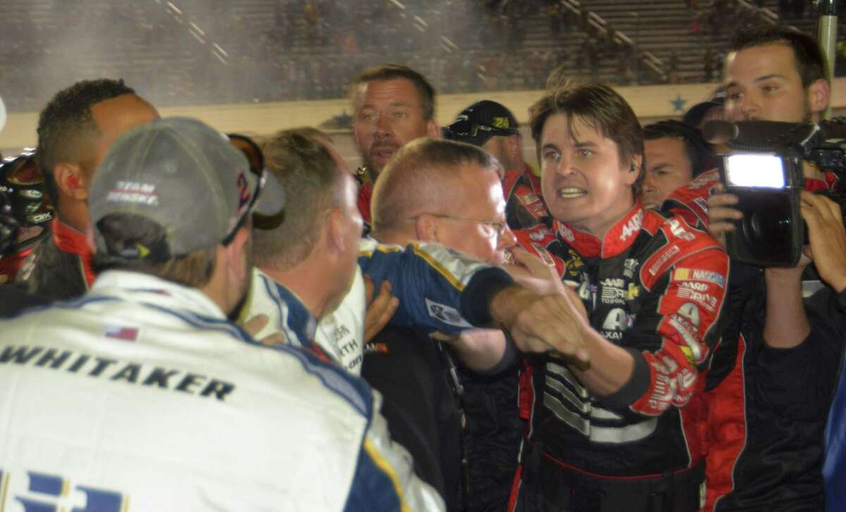 Pit crew members for drivers Jeff Gordon and Brad Keselowski fight on pit row after the end of the NASCAR Sprint Cup Series race at Texas Motor Speedway on Sunday.