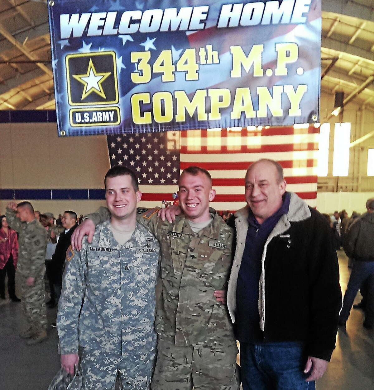 Courtesy photo From left are SSG Arron McLaughlin, his brother Spc. Kurt Schluntz of East Hampton and their father Fred Schluntz.