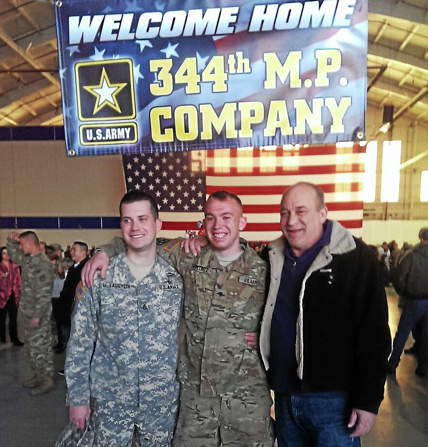 Courtesy photo From left are SSG Arron McLaughlin, his brother Spc. Kurt Schluntz of East Hampton and their father Fred Schluntz. Photo: Journal Register Co.