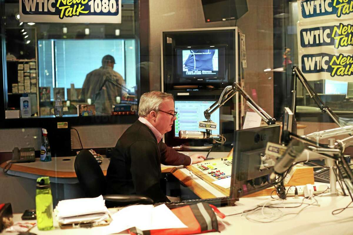 In this undated photo, former Gov. John G. Rowland works in the WTIC studio
