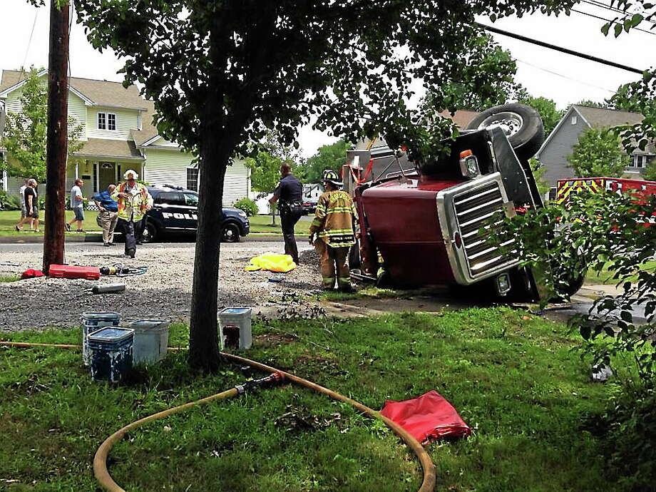 The scene of a dump truck crash on Main Street in Cromwell. The driver of the truck was hospitalized. Photo: Kaitlyn Schroyer — The Middletown Press