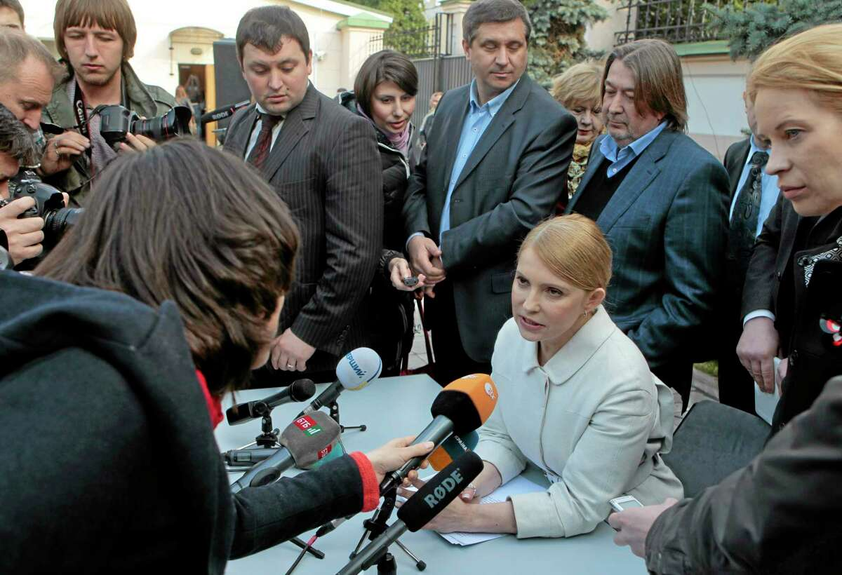 Former Ukrainian Prime Minister Yulia Tymoshenko, speaks after a press conference in Kiev, Ukraine, Thursday, March 27, 2014. Tymoshenko has announced on Thursday she will run for presidential elections set for May 25. Tymoshenko, who was released from jail last month following the overthrow of President Viktor Yanukovcyh, said Thursday that she has earned the moral right to say she will combat corruption. (AP Photo/Sergei Chuzavkov)