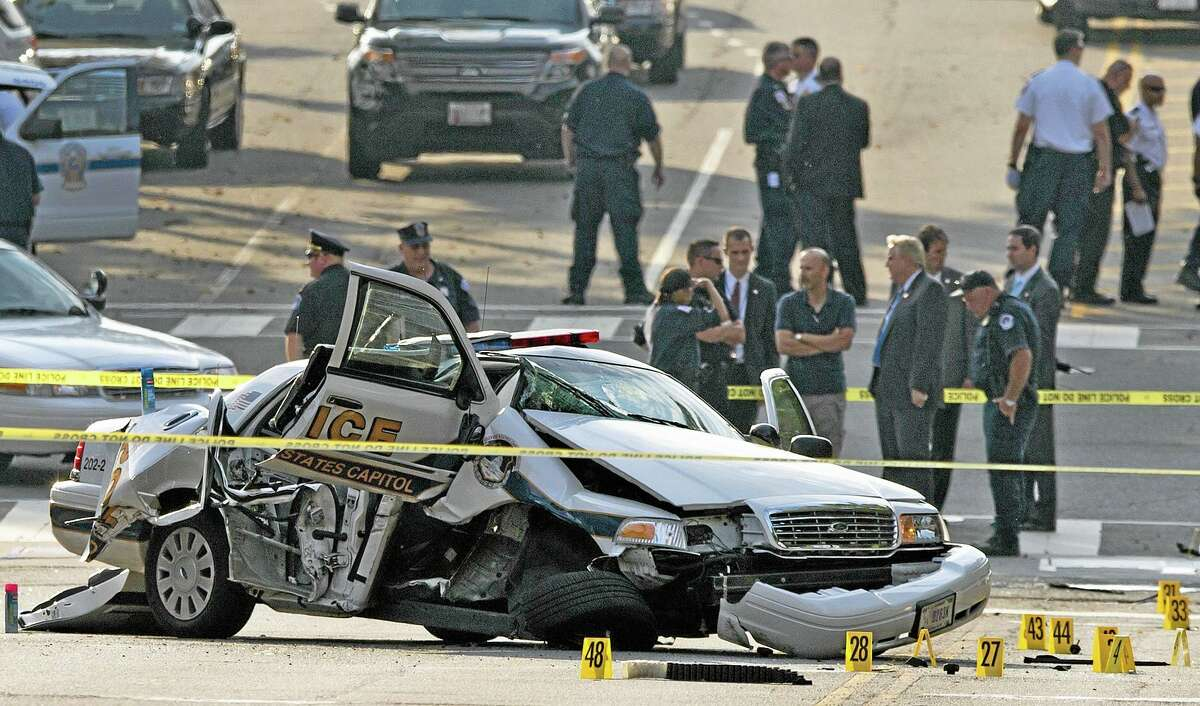 A damaged Capitol Hill police car is surrounded by crime scene tape after an Oct. 3, 2013, car chase and shooting in Washington, D.C. Police shot and killed 34-year-old Miriam Carey, of Stamford after a car chase that began when Carey allegedly tried to breach a barrier at the White House.