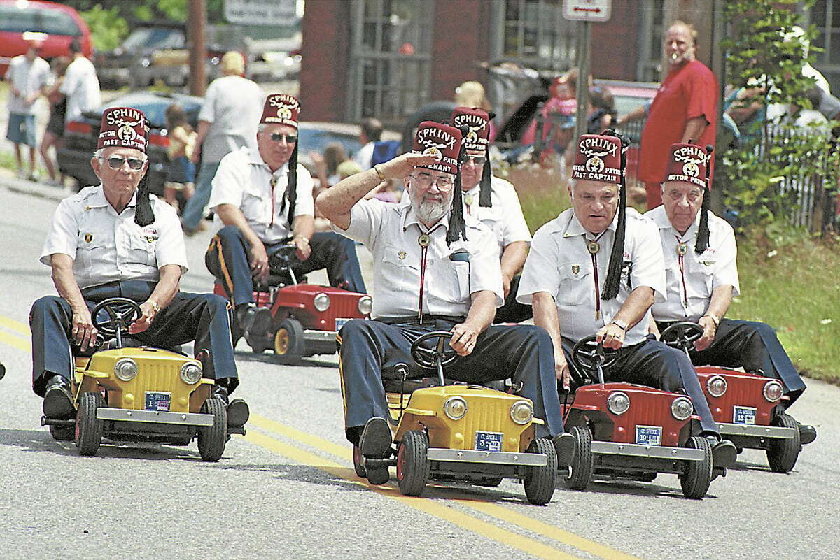 The Sphinx Temple Motor Patrol make their way down Main Street during the Old Home Days Parade in East Hampton in 2002.