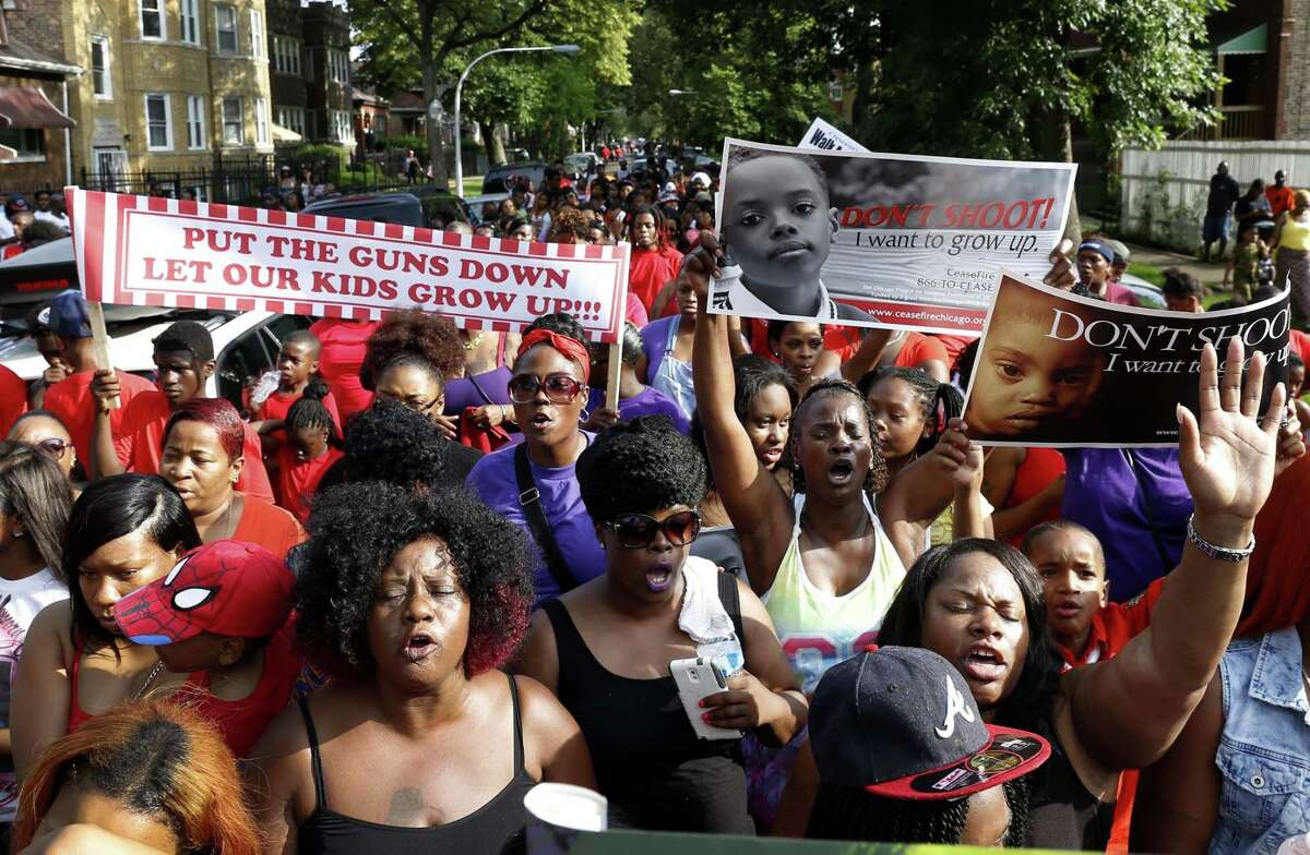 Members of the community march on Chicago's West Side to protest the death of 7-year-old Amari Brown July 6 in Chicago.