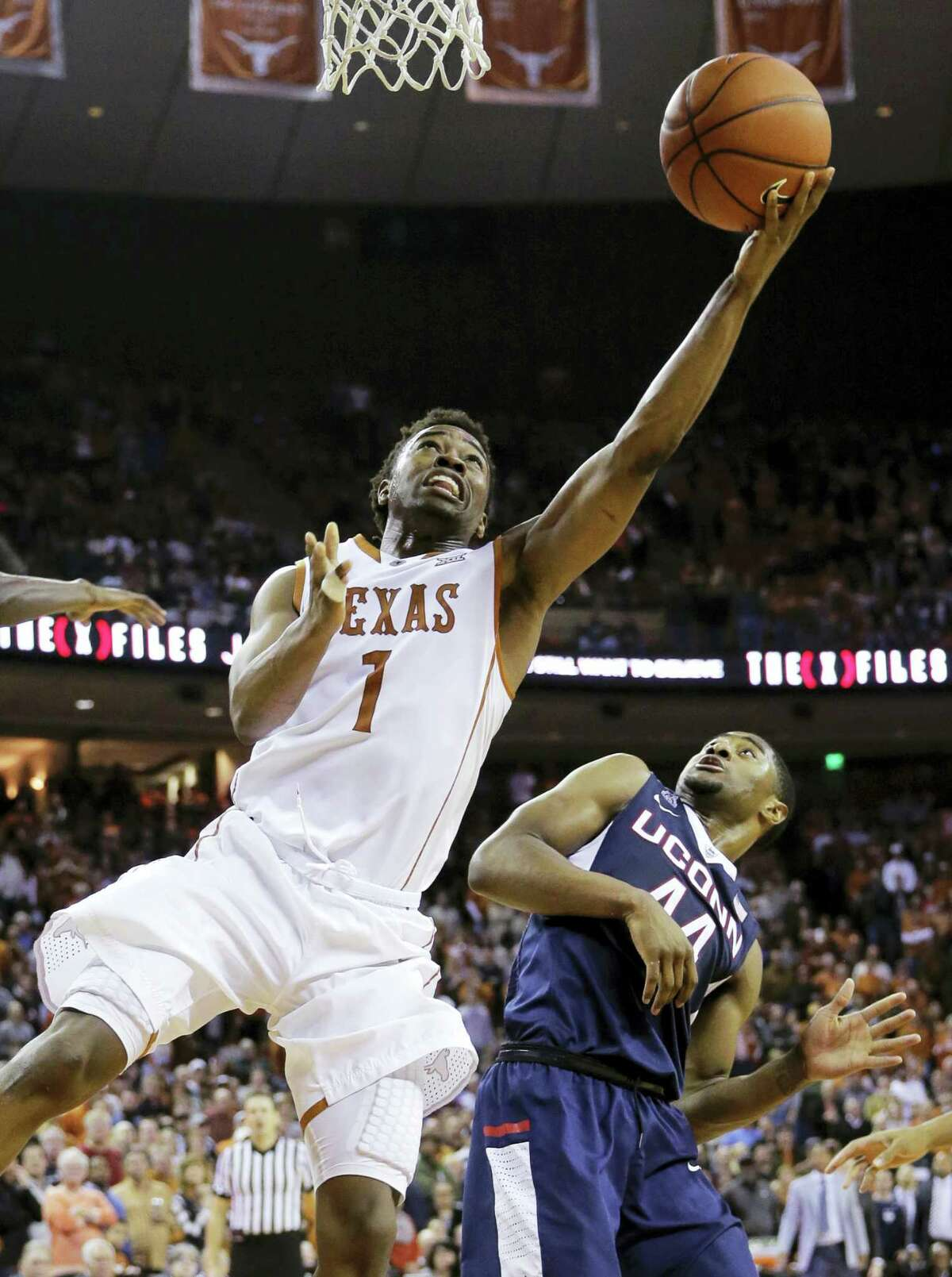 Texas guard Isaiah Taylor (1) shoots over Connecticut guard Rodney Purvis (44) during the second half of an NCAA college basketball game Tuesday, Dec. 29, 2015, in Austin, Texas. Connecticut won 71-66. (AP Photo/Eric Gay)